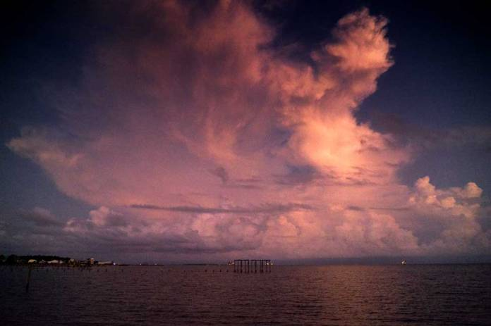 storm clouds build over Mobile Bay.